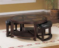 round glass coffee table with stools underneath