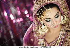 portrait of a beautiful elegant female model in traditional ethnic indian asian bridal costume with makeup