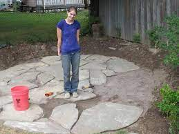a flagstone patio with irregular stones