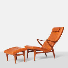 a sculptural lounge chair or chaise with ottoman the beechwood frame has a wonderful shape