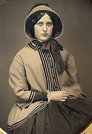 pioneer woman clothing. (1850s young woman wearing a fashion pioneer clothing