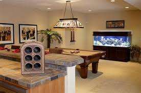 lighting basement. a combination of recessed and hanging lighting can alleviate the gloom typical traditional unfinished basements do not have to look like basement