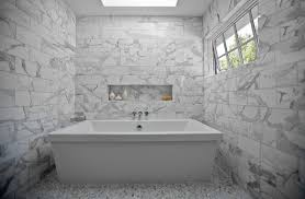 amazing marble bathroom with skylight over modern freestanding tub accented with marble subway tiled walls and white carrara marble hex tile floor