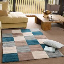 square rug in beige and teal blue to expand