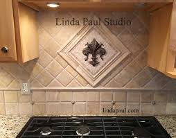 mosaic stone tile backsplash.  Stone Fleur De Lis Mosaic Tile And Metal Medallion In Mosaic Stone Tile Backsplash S