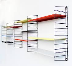 black wire frame wall mounted shelving unit with white green and res polished sheet metal trays