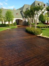 Stained and stamped driveways can give your home classic beauty that never  goes out of style