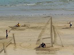 permalink to funny photo of the day art on the beach