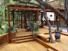 Others Captivating Wood Patio Deck Design With Tall Cast Iron Chiminea And Outside Double Spotlights Also Sling Pergola Patio Deck With Pergola Decks Backyard
