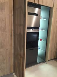 saving space in kitchen with pocket doors
