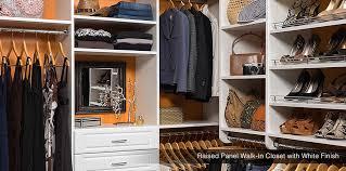 chocolate pear walk in custom closet system raised panel walk in closet with white finish