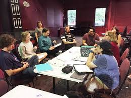 the cast gathers for a roundtable for the dac ion of next to normal at the table from left clockwise are athan garza siena widen geoff johnson