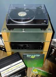 onkyo turntable. oak stax 400 hifi stand with an audio technica turntable and onkyo amplifier