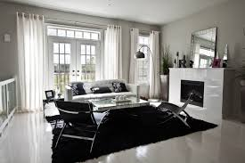 Stark Black And White Contrasts In This Modern Living Room, With White  Stained Hardwood Flooring