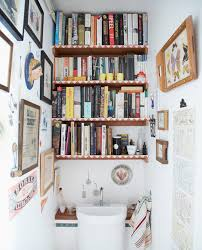 chic eclectic powderroom downstairs toilet features book shelf with wall art paired small sink  on downstairs toilet wall art with chic eclectic powderroom downstairs toilet features book shelf with