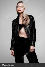 rockstar biker fashion girl wearing leather jacket stock photo