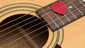 guitar picks can be made of all kinds of materials including plastic and metals