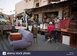 old and used furniture displayed for sale at jaffa flea market BPKHCX