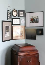 corner gallery wall how to hang art on a curved wall