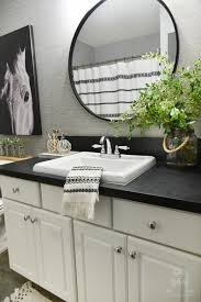 tribal chic bath rug and nautical soap dispenser and toothbrush holder are all from the better homes gardens at collection