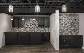 open ceiling lighting. Finished Basement With A Full Wall Backsplash, Dark Cabinets, Separate Butler\u0027s Pantry, Open Ceiling Lighting L