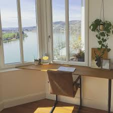 diy desk with one leg it rests on the window sill in the bay window