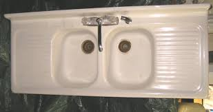 she has a beautiful cast iron double sink with the drain board on