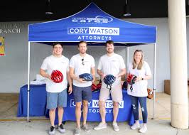 cory watson cory watson attorneys gives away 150 helmets to encourage bicycle safety
