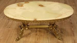 french coffee table of the 20th century chiseled and gilt furniture in brass oval