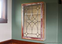 this is a picture of a wall cabinet made a vintage window