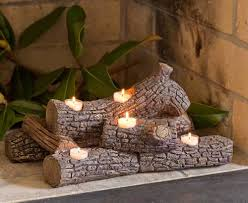 Tea Light Candle Fireplace Log This Log Shaped Candle Holder Will Make Your Apartment
