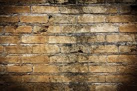 antique brick wall with vignette stock photo