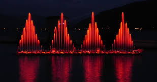 Musical fountain show lighted at night ...