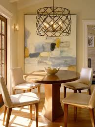 bright quoizel in dining room transitional with cage chandelier next to picture lighting alongside abstract painting and kitchen chandelier