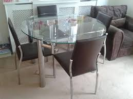 extendable glass dining table   brown dining chairs from cargo