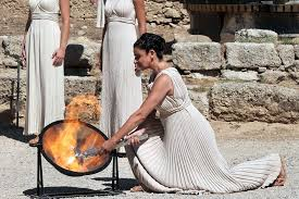 flame lighting olympics. the high priestess, whose role is third time by actress ino menegaki,. in tradition of lighting olympic flame olympics i