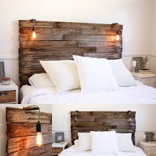My recycled rustic fence pailing timber bedhead. Lamp Kmart hack for the  lighting and Kmart