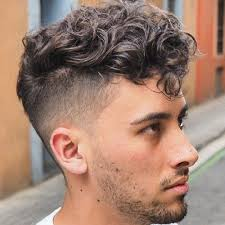 curly hair undercut with short fringe and stubble