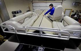 oakdale inventor s pontoon boat unfolds to seat 16 with a press of a on twin cities