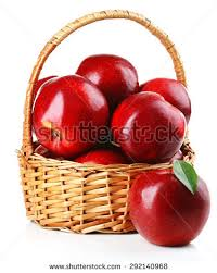 green and red apples in basket. red apples in wicker basket isolate on white green and n