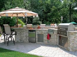 outdoor kitchen projects. outdoor kitchen with stone veneer on paver patio projects a