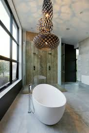 grouped pendants over bathtub for a dramatic effect