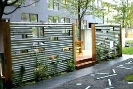 corrugated metal fence. Sheet Metal Fence Corrugated Panels Zinc Steel With Playful Cut Outs .