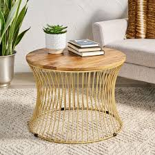 This voluminous drum cocktail table is made of iron then finished in burnt brass, a golden finish a bit lighter than antique brass. Style Your Living Room With A Drum Coffee Table
