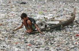 water pollution effects cause and effect essay sample boy looking at dirty water