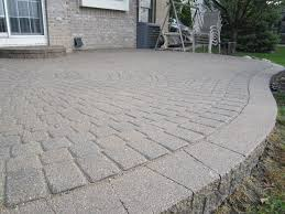 after 13 years this raised paver patio needed some repair restoration