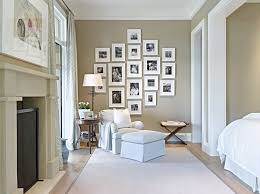 picture frames multiple bedroom traditional with gray upholstered armchair white ceiling gallery wall