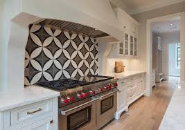 kitchen cooktop with black and white cement circle backsplash tiles