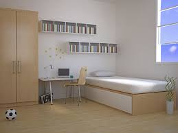 this minimalist bedroom features a bed a desk a closet and small shelving
