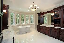 white bathroom cabinets with dark countertops. This White Marble Bathroom Holds A Pair Of Immense Dark Wood Vanities, With Array Cabinets Countertops